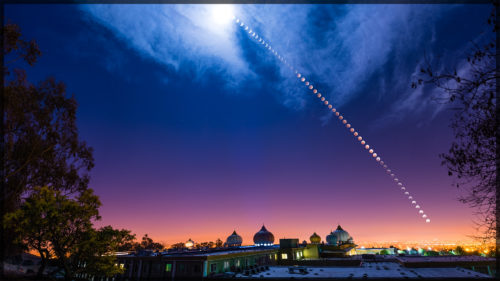 Lunar Eclipse Over Temple